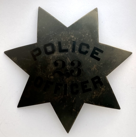 Oakland Pie Plate Police badge #23 last worn by J. J. O�Connell who was appointed 3-21-1912.