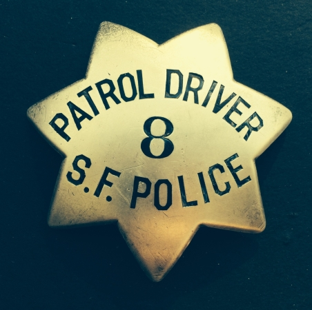 Sterling silver San Francisco Police Patrol Driver badge #8, made by Samuels Jewelry. Issued to William P. Griffin, who was appointed April 30, 1934.