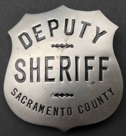 Sacramento Deputy Sheriff  badge nickel shield, hallmarked Ed Jones & Co. circa 1924.