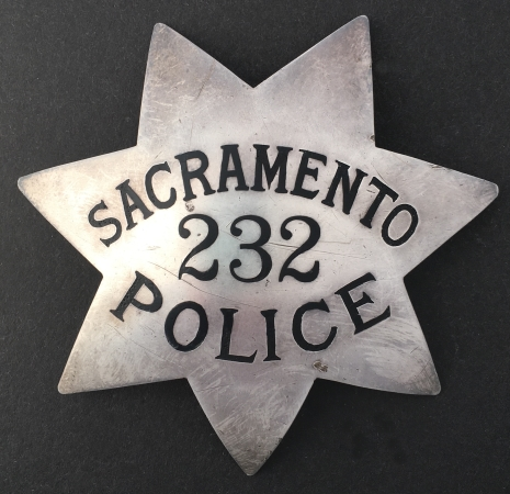 Sacramento Police Badge #232.  Sterling silver, made by Entenmann.  During the 1950's Entenmann got an order from Sacramento PD for badges.  It was a short lived relationship thus making the Entenmann version somewhat rare.
